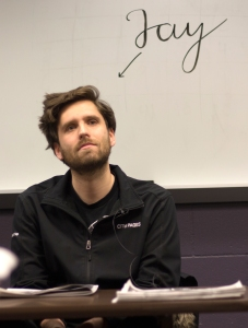 Jay Boller, music editor for City Pages, explains his role at City Pages to journalism students at Bethel University, Feb 8. He soon will switch to web and social media editor at the alternative weekly in the Twin Cities. | photo by CARLO HOLMBERG